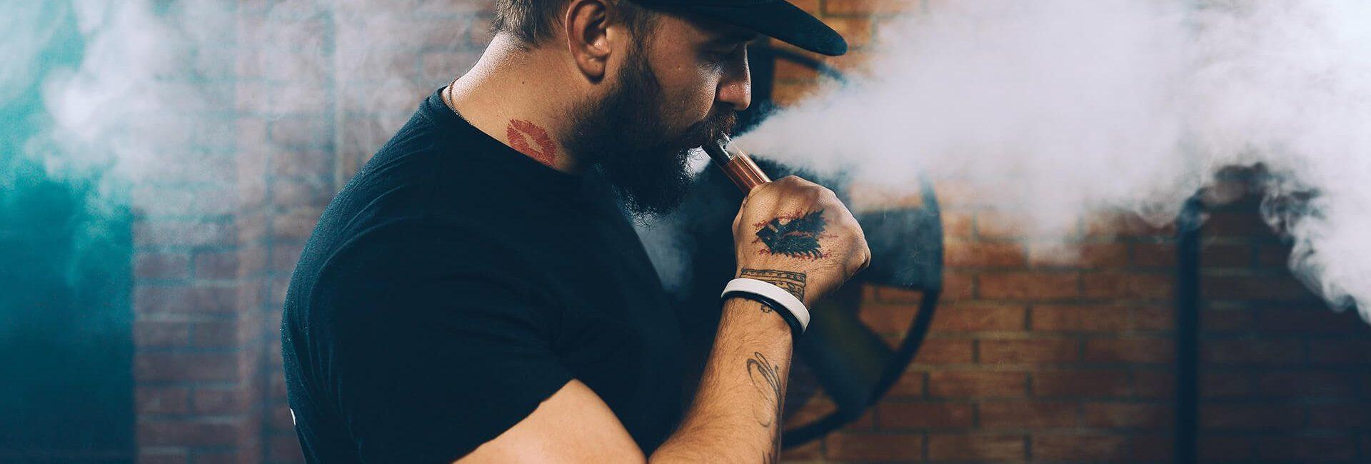 man-vaping-an-electronic-cigarette-PHZW7TQ